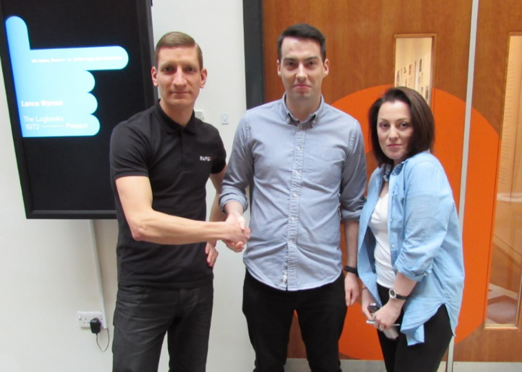 From left to right: Matt Baxter of Rapid7, competition winner David Langton, Eliza May Austin, student at Sheffield Hallam University.